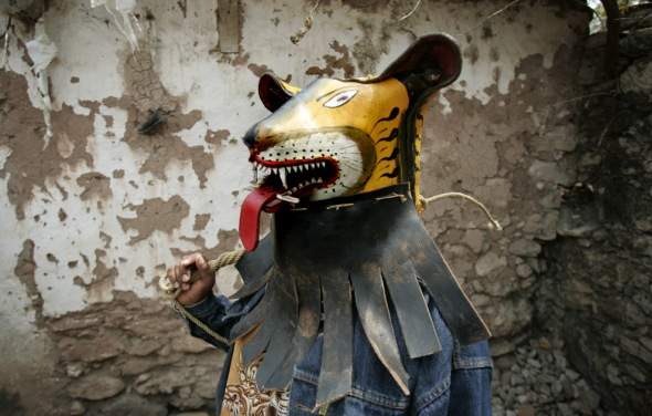 Tigre Fighter With Whip & Jaguar Mask. Copyright 2008 by the Associate Press/Eduardo Verdugo.  Used without permission.
