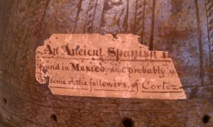 Detail of the label attached to the conquistador's helmet.